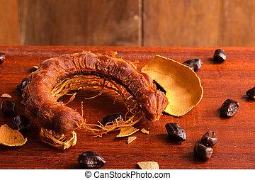 Tamarind - Sweet ripe tamarind and seeds on rustic wooden...
