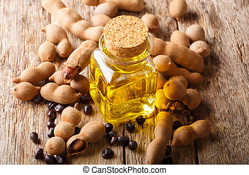 Tamarind seed oil in a glass jar close-up on a table....