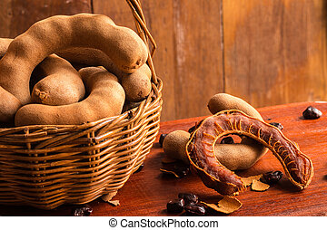 Tamarind - Sweet ripe tamarinds and seeds in the basket on...