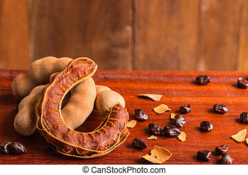 Tamarind - Sweet ripe tamarind and seeds on rustic wooden...
