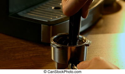 Tamping coffee in a portafilter 4k - Close-up of tamping ...