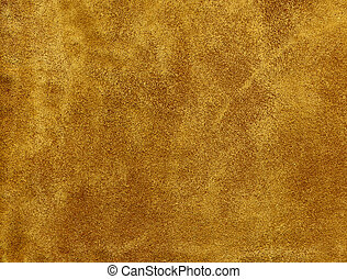 A tanned suede leather background.