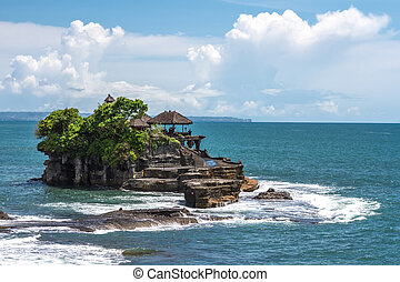 Tanah Lot temple in the ocean on a clear day