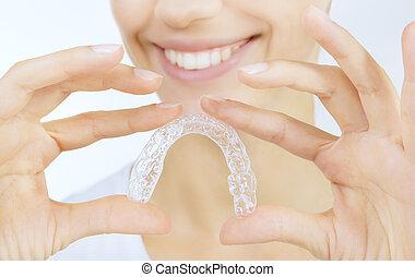 tand, meisje, blad, het glimlachen
