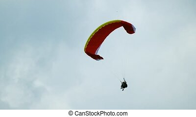 Tandem paragliders flying in the sky
