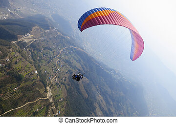 Tandem paragliding in Nepal - Tandem paragliding in Pokhara,...