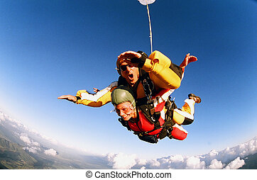 Tandem Skydive - Two people skydiving in tandem from an ...