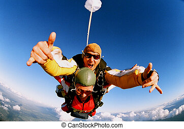 Tandem Skydive - Two people skydiving in tandem from an...