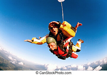 Tandem skydivers in action - Tandem skydiver in action ...