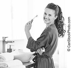 tandenborstel, verticaal, badkamer, vrouw glimlachen