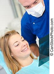 tandläkare, tålmodig, visande, röntga