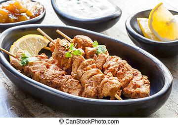 Tandoori Chicken Skewers - Tandoori chicken skewers, served...