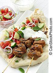 Tandoori Lamb Kebabs - Tandoori lamb kebabs with naan bread,...