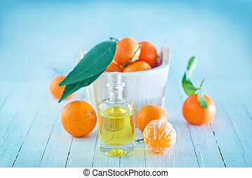 Tangerine essential oil on the white table