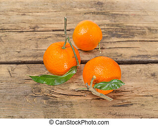 Tangerine fruits on wooden background