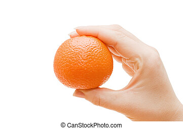 Tangerine in a female hand isolated