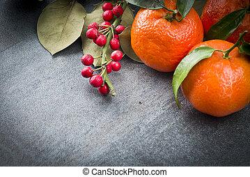Tangerine on the grey background