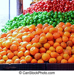 tangerine oranges lemon and tomatoes