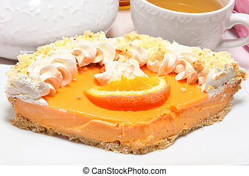 Tangerine Pie - Large piece of tangerine pie with whipped...