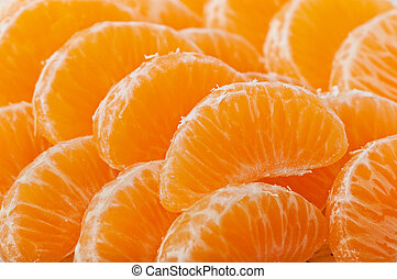 Tangerine slices on a wooden background, fruit.