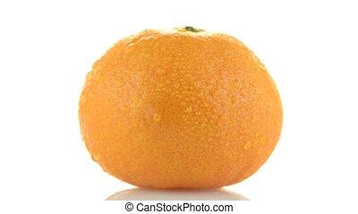 Tangerine rotating on white background.