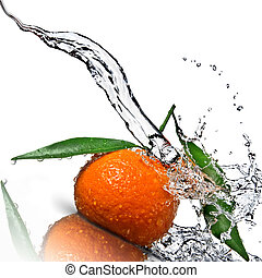 Tangerine with green leaves and water splash isolated on white