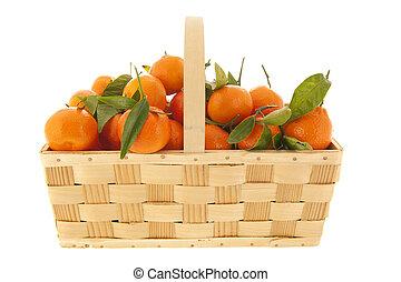 Tangerines iin basket solated over white background -...