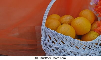 tangerines in a beautiful basket decorated with bow.