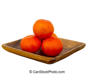 Tangerines on a wooden plate