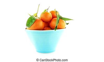 Tangerines on ceramic blue bowl