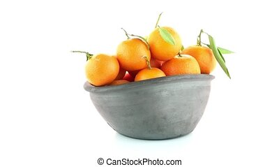 Tangerines on clay bowl