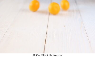tangerines on white wooden table.