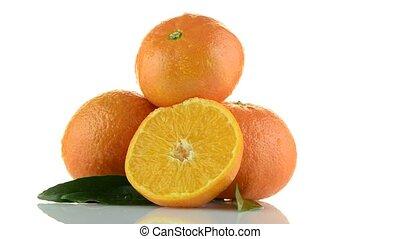 Tangerines rotating on white background.
