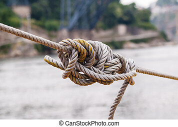 Tangled know in tightened rope.