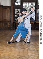 Tango Dancers Performing Corte Step In Restaurant
