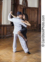 Tango Dancers Performing In Restaurant