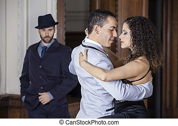 Tango Dancers Performing While Man Looking At Them