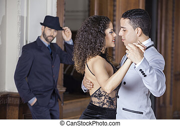 Tango Dancers Performing While Man Standing In Background