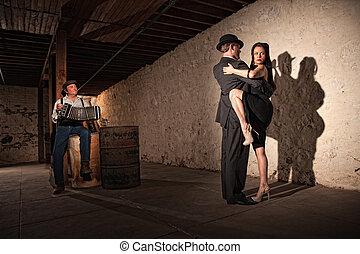 Tango Dancers With Bandonion Player - Mature tango dancers...