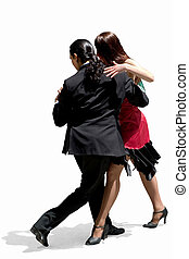 Young couple dancing Tango in the street.
