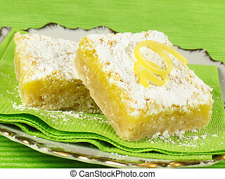 Tangy Lemon Bars - Baked lemon bars sprinkled with powdered...