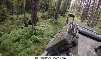 Tank driving in forest at cloudy day