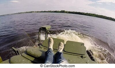 Tank driving in river swimming