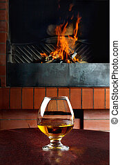Tank of cognac on the old brick fireplace