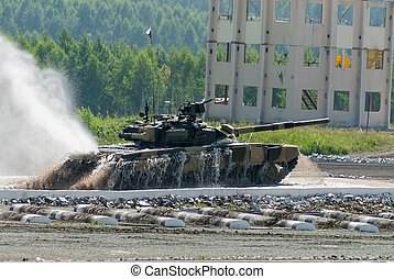 Tank T-80 moves after water ford