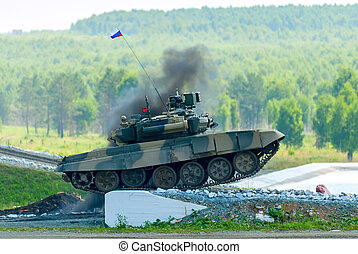 Tank T-80 overcomes a high concrete obstacle
