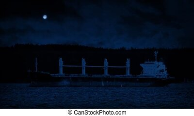 Tanker Docked In Bay At Night - Large tanker ship moored by...