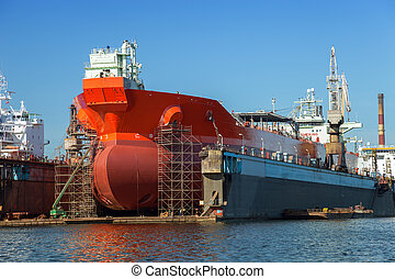 Tanker in dry dock - A large tanker repairs in dry dock....