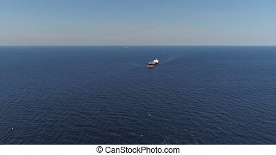 Tanker in open sea, ocean, big merchant ship vessel cruise drone flight 4k