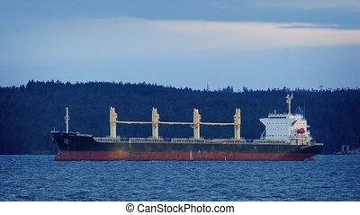 Tanker In The Bay At Sunset - Large tanker ship docked in...
